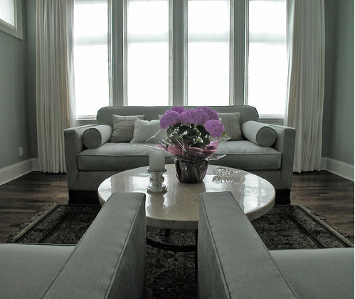 Window Treatments VA with sofa and table in living room